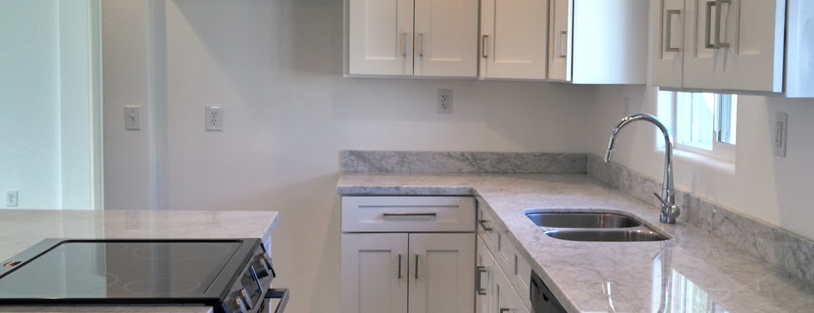 White Kitchen Cabinets With Carrera Marble Countertops